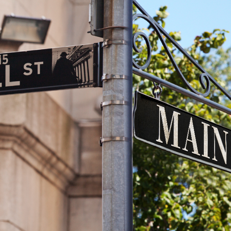 Fake intersection of Wall Street and Main Street, with different backgrounds